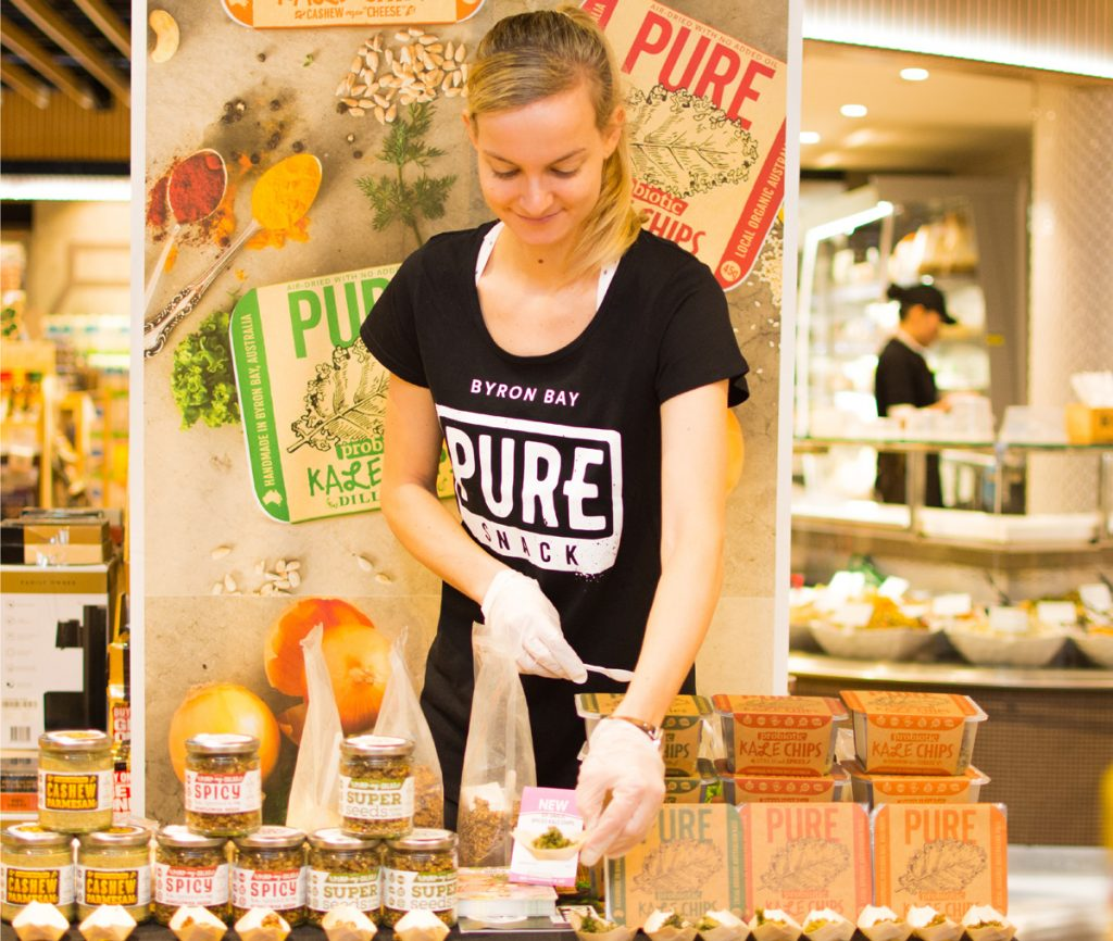 A food demonstrator setting up a display in a retail store