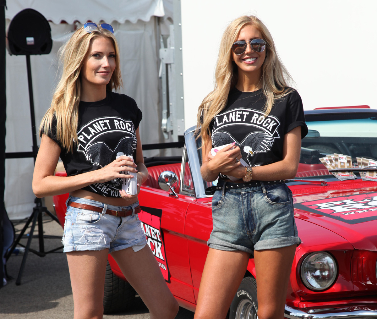 Beautiful promotional models posing for a photograph during an event