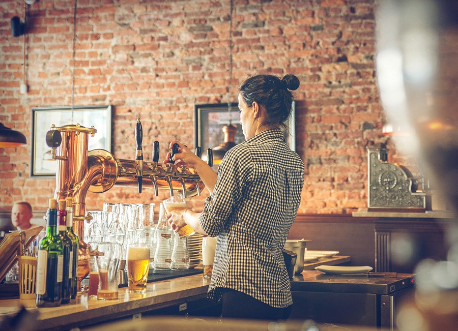 A bartender pouring beers in a venue